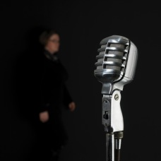 vintage microphone with singer on the background